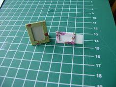 F = fotolijstje/ wissellijst modern Benodigd: - dun karton 20x60 mm - papier met dessin 30x80mm Gereedschap: - mes - liniaal en ...
