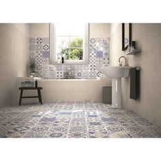 I like the colour and variety of these tiles. They add interest without being over powering.  Skyros Delft Blue Wall and Floor Tile Roomset