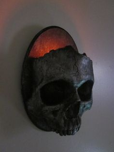 wall candle holder. Gorgeous, and I am not too proud to attempt a DIY. Molds made from a foam skull? Hey, can I get an animal skull to use? If I affix a large glass votive inside it, it'll protect it enough to burn the small scented votives I'm thinking of.