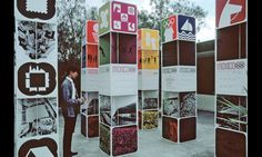 Information kiosks and exhibit towers used interchangeable panels depicting cultural and sports symbols. (Design: Peter Murdoch) #SEGD