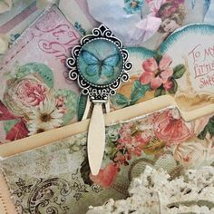 I just love those new Vintage Metal Clip Bookmarks I listed into the Reneabouquets Shops~here is a sneaky of one that I gussied up for a pocket journal I am working on~love!! http://www.Reneabouquets.com http://www.Etsy.com/shop/Reneabouquets