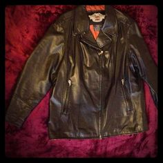 Harley-Davidson women's leather jacket Harley Davidson leather riding jacket. Zipper pockets, buttons to hold down lapel, studded logo on back and logo embroidered on left sleeve at cuff. Zipper releases at hips and cuffs. Orange lining. Size 2W. (Fits a 20/22) Gently used, excellent condition. Pet free, smoke free home. I accept reasonable offers.  Save 20% by bundling with just one other item! Harley-Davidson Jackets & Coats