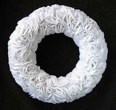 This is really cool. Made with cosmetic round pads. The blog is from Spain, but has tons of self explanatory pics with great ideas :) http://blog.hola.com/elrincondesonia/tag/navidad