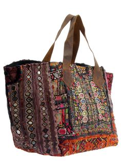 Woven tote bag in mixed fabrics and colors with mirrored disc accents and leather handle