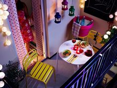 Cozy balcony, love the hanging lamps
