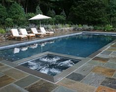 I am putting in a pool early next year, mainly for water aerobics, just 4ft deep with a jacuzzi. I want a rectangle like this, very modern with stone edging.