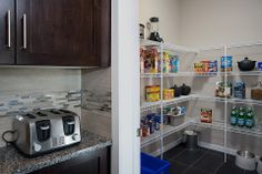 A hidden area to prep and store food!  It's like a butler pantry!  What a nice big space to help you stay organized.  Excel Homes- Manning show home, Heron Pointe at Reunion, Airdrie