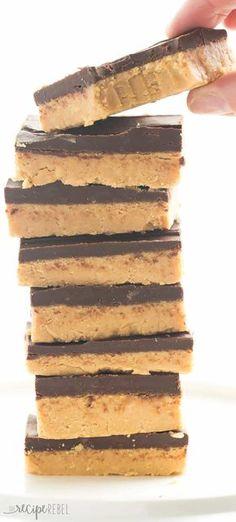 ~ YUMMY IDEAS ~Previous pinner writes:One ingredient makes these No Bake Chocolate Peanut Butter Bars BETTER than all the rest! They taste just like Reese's and are highly addictive! Candy Recipes, Sweet Recipes, Baking Recipes, Cookie Recipes, Dessert Recipes, Bar Recipes, Peanut Butter Chocolate Bars, Peanut Butter Recipes, Peanutbutter Bars No Bake