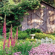 wood shed with beautiful landscaping