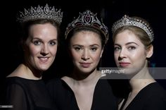 Three tiaras owned by Mary, Duchess of Roxburghe. Sotheby's auction house employees pose wearing three diamond tiaras from the estate of Mary, Duchess of Roxburghe during a press preview in London on April 8, 2015.