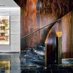 Next up is @Fendi's Manhattan flagship by @PeterMarinoArchitect. Salvaged palisander-veneered paneling defines the luxury store's staircase, beside which stands a bronze pedestal displaying a 1950's terra-cotta Janus head. : Douglas Friedman. @sandow #architecture #interior #design #interiordesign #fendi #shopping #retail #nyc #newyork #manhattan #blackfriday... - Interior Design Ideas, Interior Decor and Designs, Home Design Inspiration, Room Design Ideas, Interior Decorating, Furniture And…