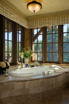 curved tile bathtub, roman shades. Keep this in mind when josh lets me go crazy with remodeling!