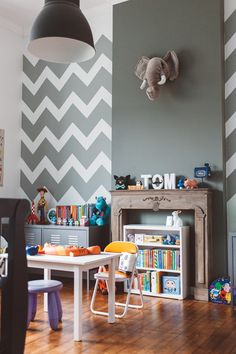Little boy's bedroom (love this old wooden fireplace)