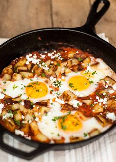 Why not serve eggs for dinner?! Fried potatoes and eggs baked in spicy tomato sauce and topped with some goat cheese.