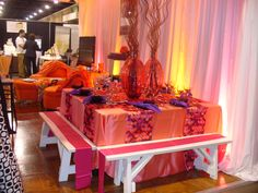 white benches with pink satin sashes and fiesta coral satin linen