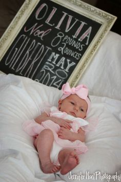 newborn photography - a fun sign with the birth info is a fun touch