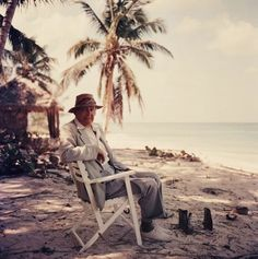 Eliot, on the beach. Eliot at Love Beach, New Providence Island, Bahamas Photo by Slim Aarons Slim Aarons, Art Photography Portrait, Color Photography, Portraits, New Providence Bahamas, American Poets, Lightning Strikes, Attractive People, Taking Pictures