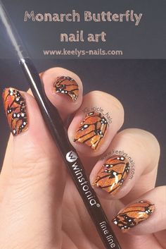 Butterfly wing nails are really eye-catching and work in so many colours! I used orange holographic polishes to create my Monarch Butterfly nail art. Nail art by Keely's Nails