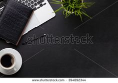 Office leather desk workplace table with laptop, coffee cup, notepad and plant. Top view with copy space