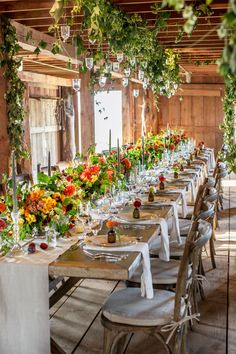 Flowers are front and center at this farmhouse table. Place candles around the display and your blooms will illuminate as the sun sets.