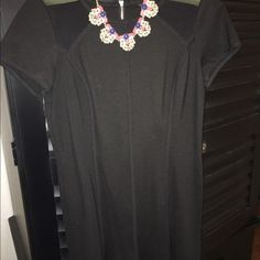 Little black dress Form fitting black dress. Sheer in the shoulders. Short sleeve, flares at the bottom. Ann Taylor Dresses Midi