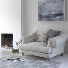 Snuggle chair in cream or white, grey blankets and cushions. With grey sofa, duck blue accents?