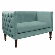 """A sophisticated addition to your den or living room seating group, this pine wood loveseat showcases tufted detailing and chic nailhead trim. Handmade in the USA.  Product: LoveseatConstruction Material: Solid pine frame, polyester and polyurethane foam padding and fabricColor: CaribbeanFeatures: Handmade in the USAButton-tufting Nailhead trim Dimensions: 33"""" H x 52"""" W x 28"""" DAssembly: Easy assembly requiredCleaning and Care: Spot clean only"""