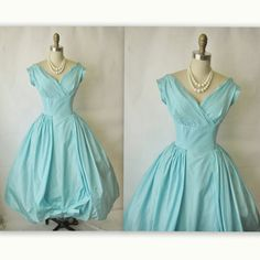 Perfect teal retro dress for brides or bridesmaids (if i have like a black and teal wedding or something