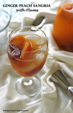 Ginger Peach Sangria with Plums from Whole Food | Real Families. A perfect cocktail recipe for warm weather parties with friends! www.wholefoodrealfamilies.com