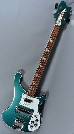 2002 Rickenbacker Turquoise 4003 Bass Guitar. Gorgeous...the best way to describe this bass. This rare color, used for a limited time, has such an amazing look. Overall this instrument is really sweet, both playing and sounding great. Finish has some surface scratches. some small dings but no cra...