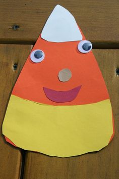 Halloween Kids' Craft: DIY Paper Candy Corn #halloweencrafts #halloweenkids #halloweenkidsactivity