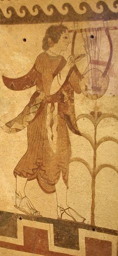 470 BCE. Etruscan, painted fired terra cotta tomb wall decoration. The young female lyre-player walks in sandals tied around ankles, holding her instrument by a cloth strap attached to her left wrist, she strums it with a plectron in her right hand. Red, blue-black, and surface green on white ground. MFA.