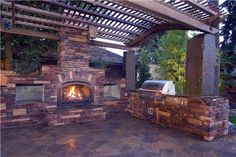 Outdoor Kitchen And Fireplace  Pergola and Patio Cover  Copper Creek Landscaping  Mead, WA