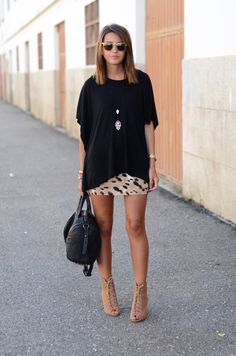 Contrast is complementing! A large, long, loose fit, plain oversized top on a printed, tight, mini skirt. Gotta love it. Either with heels, flats or low chucks. Yes.