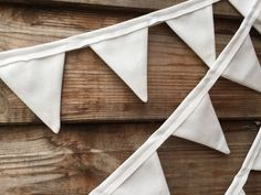 This mini white bunting is beautiful and charming and perfect to use as a wedding decoration. Total length 3.7m Total of 47 flags Each flag measures 6x8cm. Each flag is cut from cotton fabric using scissors. As the fabric has an unfinished edge it means that the flags will have a slightly frayed edge but this adds to the beautiful appearance of the bunting. The flags are sewn onto bias binding. There is 9cm of binding at each end to allow you to attach the bunting. Please visit my shop for…