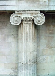 Greek column in the British Museum. This is an ionic column which has the scrolls at the capital (top). Doric columns were the original, with little adornment, while Corinthian were the later, with leaves and floral patterns sculpted in stone. The column would have to be one of the most oft repeated architectural elements/adornments in history.
