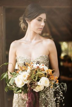 A gorgeous fall wedding #bouquet with orange, green, cream, and purple.