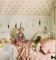 Adorable little girls bedroom. Love the star wallpaper on the ceiling. I love the bedding & mixture of patterns & textures.  Cottage Chic. The Little girl is so cute! Paisli would love it!