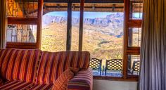 6 bed cottage Lounge with a view at Thendele Camp in the Royal Natal Park located in Northern Drakensberg, KwaZulu-Natal