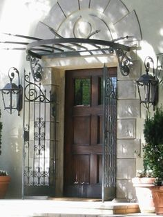 Wrought iron canopy & gates over entry into Italian style villa, Brentwood, California.