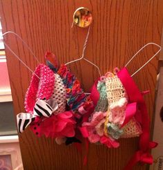 DIY HEAD BAND HOLDER! I Was looking for a good quick way to organize my baby girls head bands and came up with this idea! I looked on Pinterest and what I found was to time consuming or I didn't have the things I needed to make it! This works great and I love it!! You can wrap the hanger in ribbon to make it pretty if you'd like but works great either way!! ;) Invented by~ Adele' Davis~