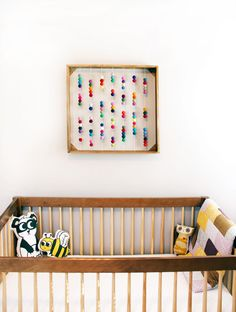 DIY Abacus Inspired Art Piece - love the use of felt balls for a fun twist on a classic! #nursery