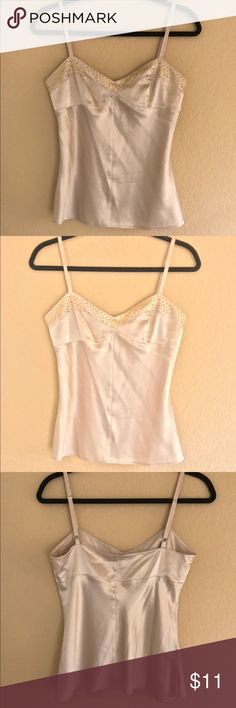"""Express Design Studio camisole sz XS Beautiful champagne color with gold studs, 92% silk 8% spandex.  Armpit to armpit measurement is 16"""" and back of top down to the bottom is 13 3/4"""".  One strap Is a little wrinkled please see the picture. My iron would not get hot so I couldn't iron it out. It will iron out. express design studio Tops Camisoles"""