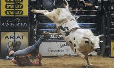 The heart-stopping moment a rodeo rider cheated death after his boot got caught in the rope of a raging bull