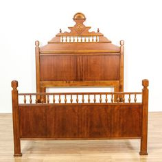 This king-sized bed frame is featured in a solid wood with a walnut stain. This traditional style bed has round finial tops, intricately carved details, and curved sides. Regal bed that's fit for any bedroom! #americantraditional #beds #bedframe #sandiegovintage #vintagefurniture