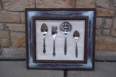 Elegant vintage kitchen decor made from old frame and utensils from thrift store.