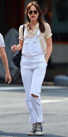 Who says blondes have more fun?: Dakota Johnson showed off her darker tresses while steppi...