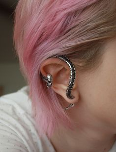 I want one of these earring except none of them come in actual gauges :(