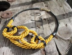 Hello yellow rope necklace four circles with black beads by byRK on Etsy (null)