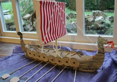 model long boat and oars
